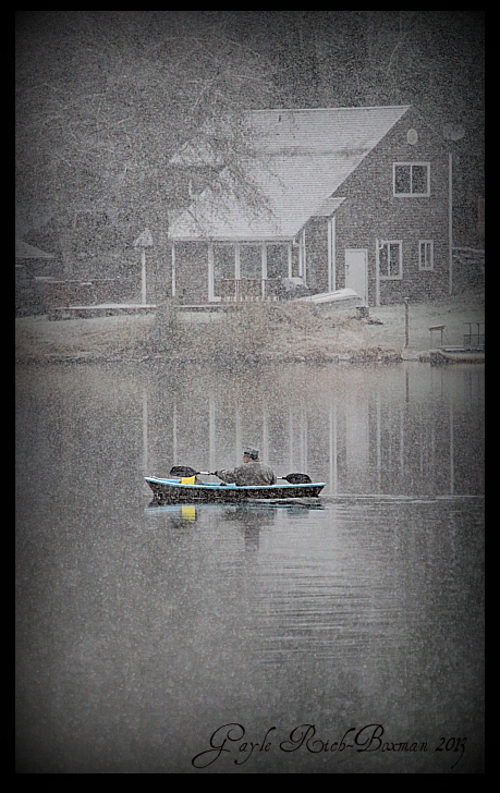 Kayaker on Fishhawk Lake During a New Snowfall New Year's Eve